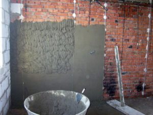 штукатурка на кирпичной стене